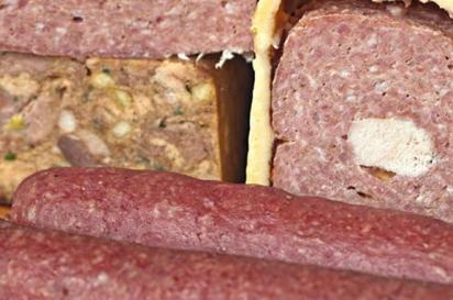 Chez Pascal's bacon-wrapped pâté, head terrine, pâté en croûte and salami