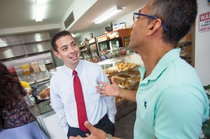 Mayor Diossa with La Sorpresa Bakery co-owner Hernan Florez