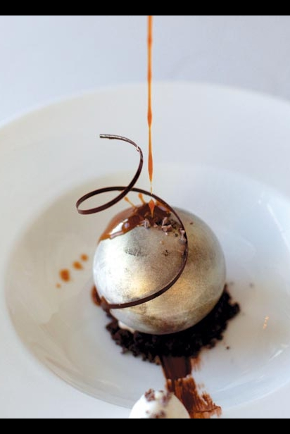 Chocolate Globe Covered In Edible Gold Leaf