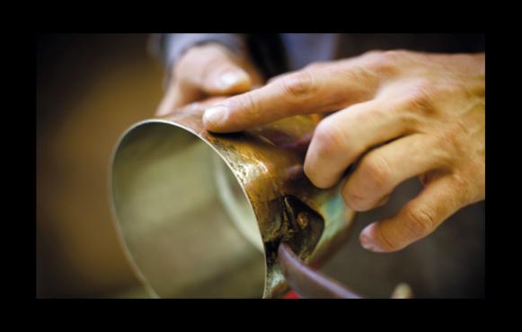 Jim Hamann retins copper pots