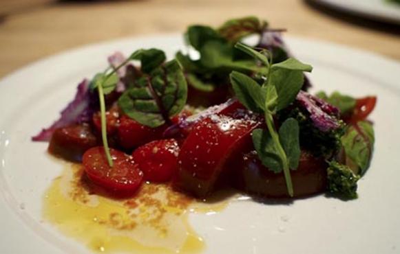 Heirloom Tomato Salad with Gorgonzola, Shaved Cauliflower, Swiss Chard Pesto & Cherry Tomato-Coriander Vinaigrette