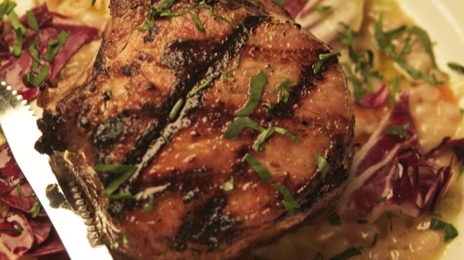 Wood Grilled Pork Chops over Cannellini Soffritto with Radicchio
