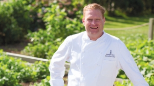 Executive Chef Karsten Hart by the gardens at Castle Hill Inn.