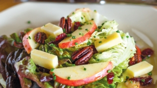 Boston Bibb salad made with spiced pecans and a vinaigrette with fresh apple cider