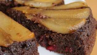 Slice of Chocolate & Pear Upside Down Cake with Fresh Cranberries